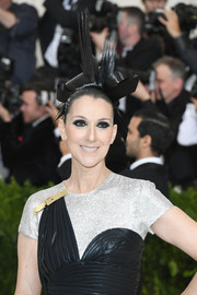 Celine Dion showed off a sculptural updo at the 2017 Met Gala.