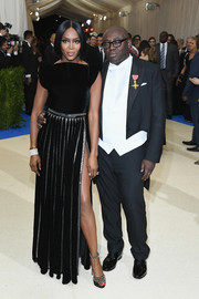 Naomi Campbell coordinated her dress with a pair of studded platform sandals.