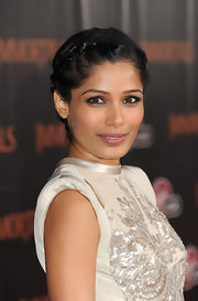 Freida Pinto wore her hair in elegant french braids at the world premiere of 'Immortals.'