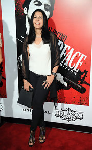 Maria Conchita Alonso arrived at the release of 'Scarface' on Blu-ray looking confident, comfortable, and glowing. Her long, layered haircut is also perfectly sleek and smooth.