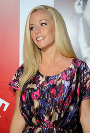 Kendra Wilkinson-Baskett attended the release of 'Scarface' on Blu-ray wearing nude lipstick with just a hint of peach.  The warm shade and subtle shine was the perfect complement to the vibrant print of her dress.