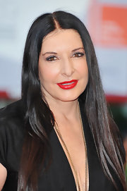 Marina Abramovic added a bright splash of color to her dark look with a swipe of red lipstick.