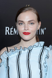 Madeline Brewer attended Remy Martin's special evening with Jeremy Renner wearing a simple side-parted ponytail.