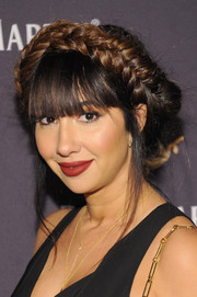 Jackie Cruz sported a voluminous crown braid and her signature eye-grazing bangs at the One Life/Live Them event.
