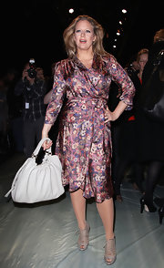 Barbara Schoeneberger looked fabulous in a floral satin wrap dress at the Fall 2011 Rena Lange fashion show.