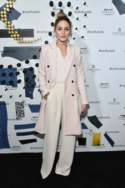 Olivia Palermo finished off her jumpsuit with a lightweight pink coat.