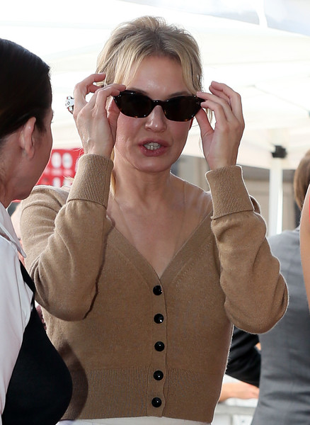 Renee Zellweger Cateye Sunglasses [harry connick jr.,star,honored with star on hollywood walk of fame,eyewear,sunglasses,glasses,cool,vision care,gesture,outerwear,arm,muscle,finger,hollywood walk of fame,california]