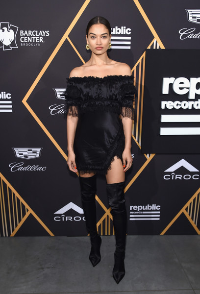 Shanina Shaik amped up the allure with a pair of thigh-high satin boots.