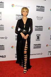 Zendaya Coleman changed out of her menswear-inspired Grammys ensemble into this sultry black number by Fausto Puglisi for the Republic Records after-party.