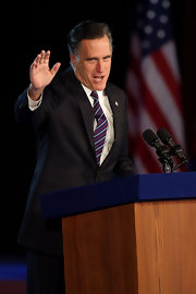 Mitt Romney kept it classic with a black suit and a striped tie during an election night gathering.