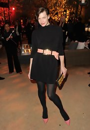 Milla Jovovich belted this black dress for the Restoration Hardware Spring 2012 launch in LA.