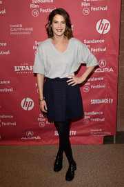 Cobie Smulders teamed her mini with an oversized gray V-neck tee.