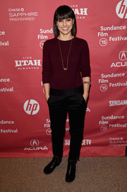 Constance Zimmer chose a pair of low-waist black slacks to team with her sweater.