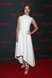 Olivia Wilde looked exquisite at the Revlon Love is On event in a sleeveless white A.W.A.K.E. dress with flower detail and a high-low hem.
