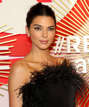Kendall Jenner wore her hair in an edgy twisted bun at the #REVOLVEawards.