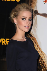 Amber Heard wore her hair in a casual loose bun at the Paris premiere of 'Rhum Express.'