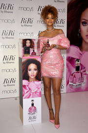 Rihanna was pure sweetness in this pink lacquered-lace off-the-shoulder dress by Vivienne Westwood Red Label during the unveiling of her new fragrance.