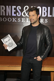 Ricky sports a sleek black leather jacket for his book signing.