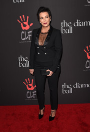 Kris Jenner was androgynous-glam at the Diamond Ball in a black Dolce & Gabbana pantsuit teamed with a cleavage-baring lace top.