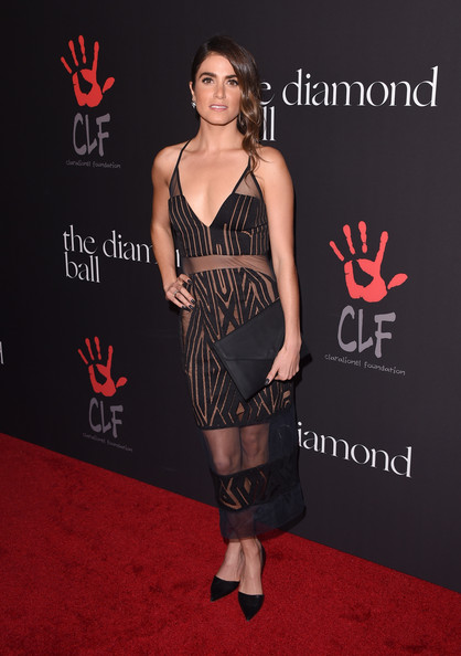 Nikki Reed chose a simple black envelope clutch to round out her look.