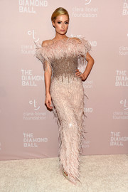 Paris Hilton paired a feathered off-the-shoulder gown by Pamella Roland with an elegant updo for total glamour at the Diamond Ball.