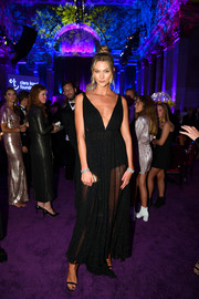 Karlie Kloss was all about sultry elegance in a sheer black dress by  Dior Couture at the 2019 Diamond Ball.