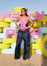 Rihanna showed off her beach body in a pink and black one-piece by Fenty x Puma at the Summer '18 collection launch.