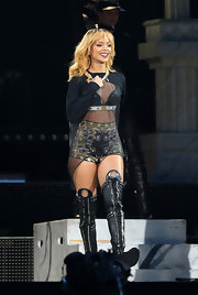 Rihanna opted for a flowing sheer tunic to reveal her embroidered shorts while performing in concert.