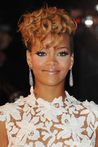 Rihanna Short Curls [hair,hairstyle,face,eyebrow,lip,chin,blond,beauty,fashion,ringlet,rihanna,nrj music awards 2010,arrivals,cannes,france,palais des festivals]
