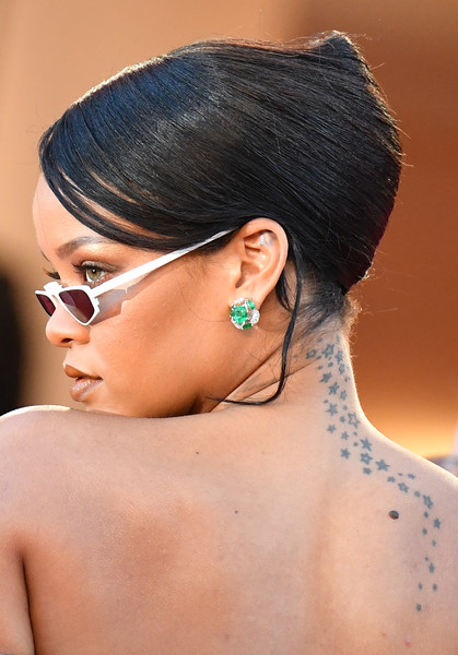 Rihanna French Twist [film,photo,beauty,eyebrow,chin,hairstyle,black hair,forehead,close up,shoulder,neck,hair coloring,red carpet arrivals,rihanna,okja,barbadian,cannes,france,cannes film festival,screening]