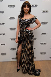 Daisy Lowe looked totally red carpet-ready in a draped silver and black off-the-shoulder gown at the Rimowa flagship store opening in London.