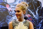 Nicola Peltz attended the 'Transformers: Age of Extinction' press conference wearing a rocker-glam messy updo.