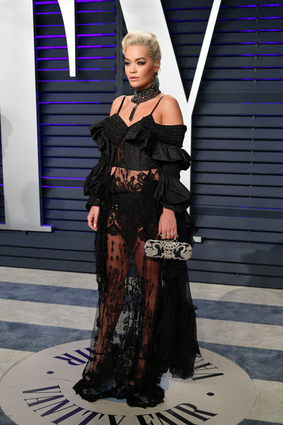 Rita Ora Hard Case Clutch [oscar party,vanity fair,fashion,clothing,haute couture,fashion model,dress,runway,fashion design,gown,fashion show,gothic fashion,beverly hills,california,wallis annenberg center for the performing arts,radhika jones - arrivals,radhika jones,rita ora]