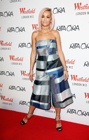 Rita Ora finished off her red carpet look with a pair of tricolor strappy sandals.