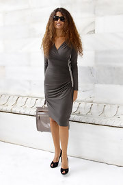 Afef Jnifen's gorgeous gray wrap-dress showed off her enviable figure at Milan Fashion Week.