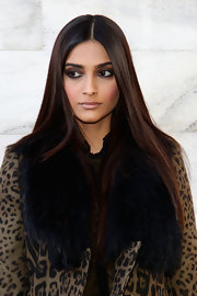 Sonam Kapoor sported a shampoo ad-worthy straight center-parted 'do at the Roberto Cavalli fashion show.