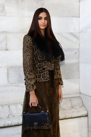Sonam Kapoor went all out with the animal prints in this cropped jacket and maxi dress combo at the Roberto Cavalli fashion show.