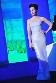The British actress wore a white strapless sequined Armani Privé Spring 2010 gown. She opted to wear the dress without the moon crescent which was presented on the runway which takes nothing away from her elegant gown.