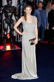 Ashley James accessorized with an ultra-elegant metallic silver clutch with a laser-cut flap.