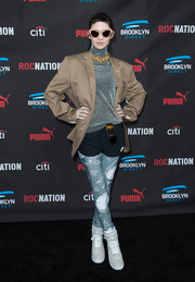 Grimes gave a whole new meaning to the layered look with this tan boyfriend blazer, silver turtleneck, black shorts, and print leggings combo at the Roc Nation pre-Grammy brunch.