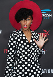 Janelle Monae's red Gladys Tamez Millinery hat and Moschino polka-dot suit at the Roc Nation pre-Grammy brunch were a very punchy pairing!