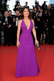 Salma Hayek's crazy curves were displayed to advantage in a plunging purple Gucci gown during the 'Rocco and His Brothers' premiere in Cannes.