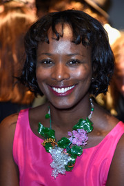 Shala Monroque attended the Rochas fashion show wearing short curls with baby bangs.