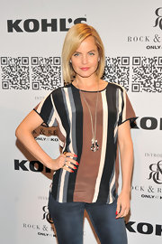 Mena Suvari wore glossy red polish on her lengthy stiletto nails at the Rock & Republic for Kohl's event.