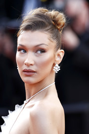 Bella Hadid polished off her look with a pair of diamond chandelier earrings by Bulgari.