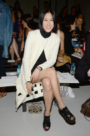 Eva Chen was retro-chic in a white coat with a lattice hem during the Rodarte fashion show.