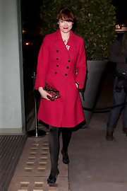 Jasmine Guinness chose a classic wool coat in this vibrant red hue for her evening look.