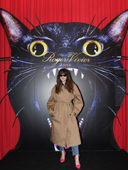Eleonora Carisi arrived for the Day Dream Vivier event wearing an oversized tan trenchcoat.