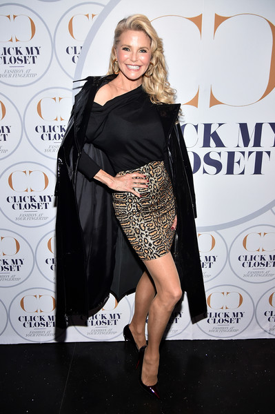 Christie Brinkley arrived for the launch of Click My Closet looking fierce in a black patent coat.