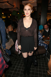 Rumer Willis flashed some cleavage in a deep-V sweater while attending the grand opening of Roku.